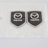 Продам 3D металлическую наклейку (эмблему) для Мазды