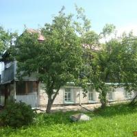 Дом 100 м² (бревно) на участке 16 сот.