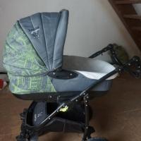 Продам детскую коляску в отличном состояниию.качели в подаро